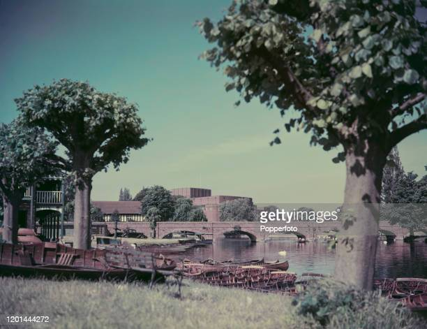 View from the banks of the River Avon of the Tramway Bridge and Royal Shakespeare Theatre in the town of StratforduponAvon in Warwickshire England in...