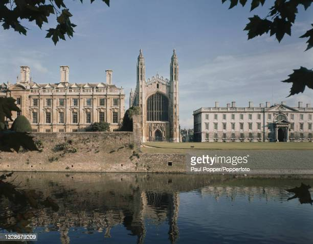 View from the banks of the River Cam in the Backs area of King's College Chapel in Cambridge, Engand circa 1965. The buildings of Clare College are...