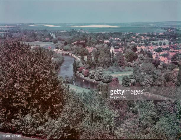 View from the Berkshire Downs above Streatley of the River Thames flowing through the Goring Gap with the village of Goring-on-Thames in South...