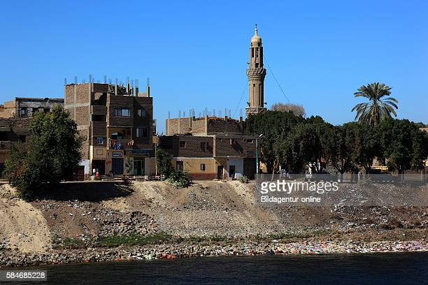 View from the boat on the Nile to residential town Esna with ist mosque Upper Egypt
