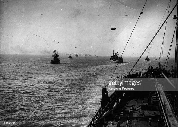View from the bridge of an oil tanker during the last lap of its voyage home from the United States, in a convoy and showing barrage balloons flying...