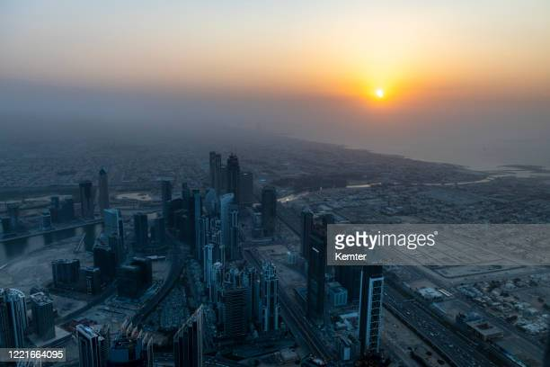 view from the burj khalifa at sunset - tower stock pictures, royalty-free photos & images