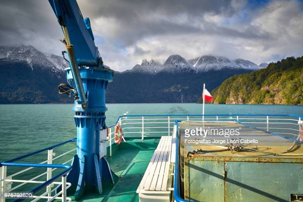 a view from the catamaran desk of the surrounding mountains during the winter andean lake crossing - azul turquesa stock pictures, royalty-free photos & images