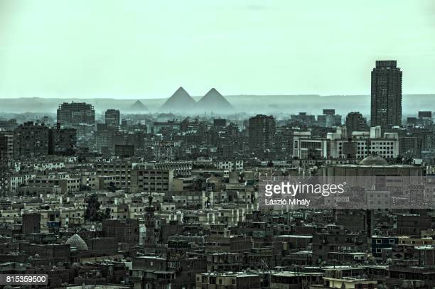 view from the citadel on the great pyramid complex of giza and the city center of cairo. - pyramid shapes around the house stock pictures, royalty-free photos & images