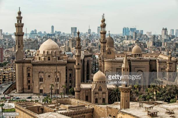 view from the citadel on the madrasa of sultan hassan mosque and the city center of cairo, egypt._2 - cairo stock pictures, royalty-free photos & images