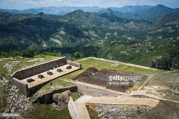 view from the citadelle laferrière, of its own field of cannons, massive stacks of cannon balls, and the surrounding mountains - paisajes de haiti fotografías e imágenes de stock