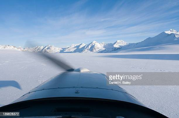 View from the cockpit of a Cessna 170 bush plane, flying over the Eagle Glacier, Chugach Mountains, Alaska