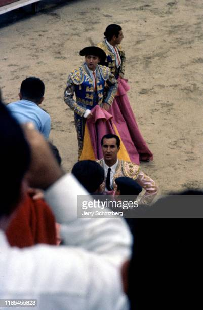 View from the crowd of Spanish bullfighter Luis Miguel Dominguin and his brotherinlaw fellow bullfighter Antonio Ordonez Araujo along with a third...