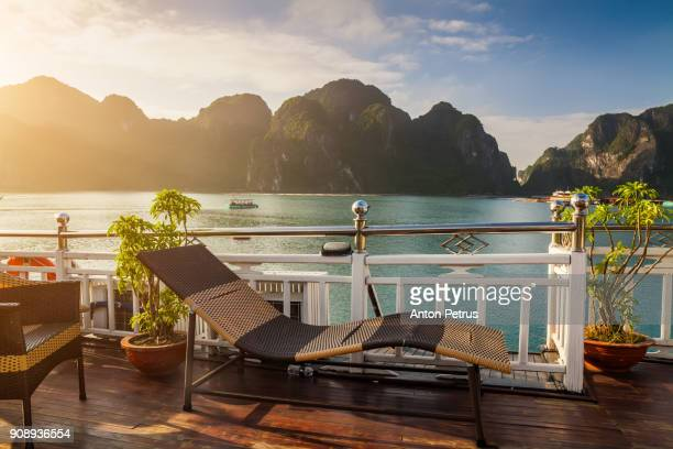view from the deck of a cruise ship. halong bay, vietnam - anton petrus stock pictures, royalty-free photos & images