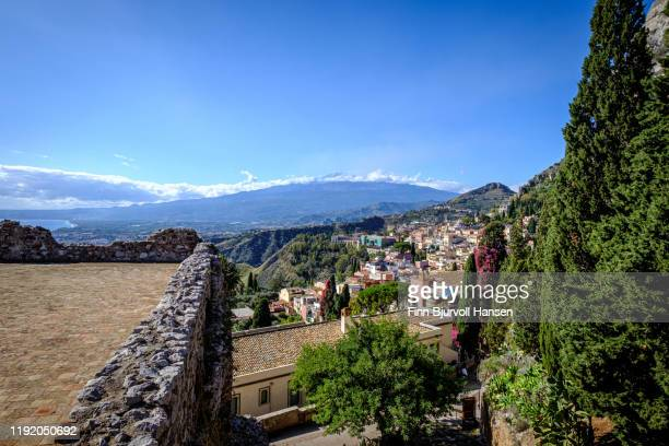 view from the entrance of the taormina greek theater, vulcano etna in the background - finn bjurvoll stock pictures, royalty-free photos & images