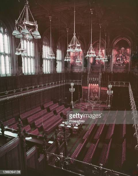 View from the gallery of the restored and redecorated House of Lords chamber with at the far end the King's Throne also known as The Sovereign's...