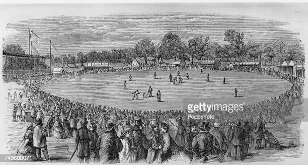 A view from the grandstand of the AllEngland Eleven in the field during a match at Melbourne Cricket Ground in Yarra Park Melbourne Victoria...