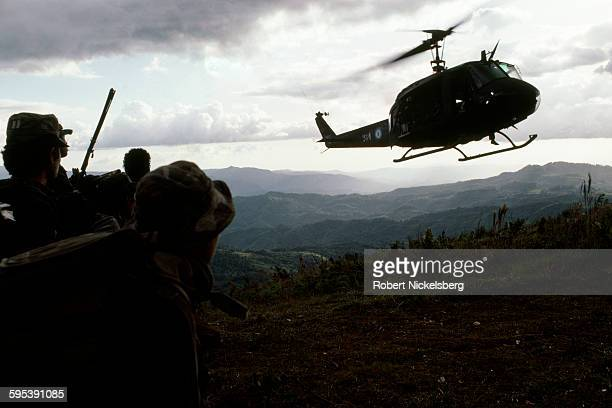 View from the ground as a Salvadoran Army helicopter lands during a military operation, central El Salvador, March 1, 1984. At the time, the country...