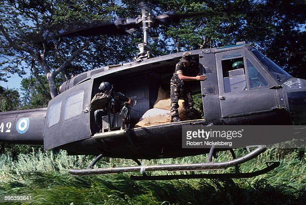 View from the ground as a Salvadoran Army helicopter lands with a resupply of food during a military operation in San Miguel Province El Salvador...