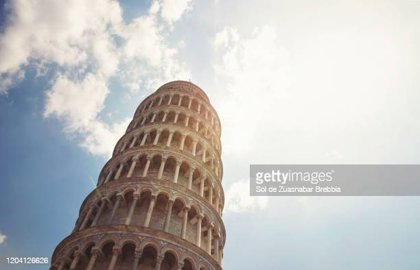 view from the ground with the look up of the leaning tower of pisa on a bright sunny day - pisa stock pictures, royalty-free photos & images