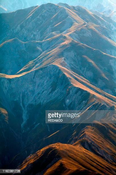 View from the high peak of the mountain near the Rifugio Duca degli Abruzzi. 2388m on Campo Imperatore. Abruzzo. Italy. Europe.