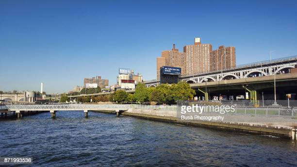 view from the hudson river of the henry hudson parkway overpass in the manhattanville area near 125th street in harlem, manhattan, new york city - henry street stock pictures, royalty-free photos & images