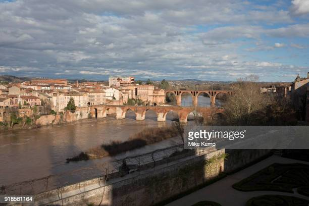 View from the Jardins du Palais de la Berbie across the Tarn River and it's old red brick bridges spanning the water in Albi Southern France