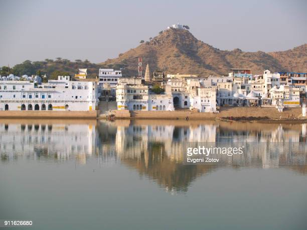 view from the lake on ghats and hilltop pap mochani temple in pushkar. rajasthan, india - pushkar imagens e fotografias de stock