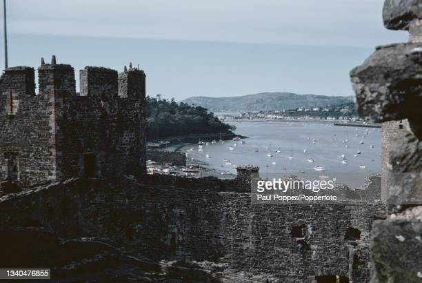 View from the medieval walls of Caernarfon Castle of boats moored on the River Conwy estuary in Caernarfonshire, North Wales in May 1969.