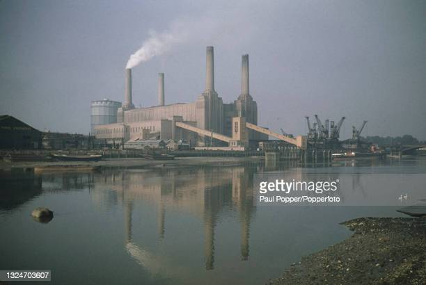 View from the north bank of the River Thames of Battersea Power Station, a coal fired power station in Battersea, London circa 1960.