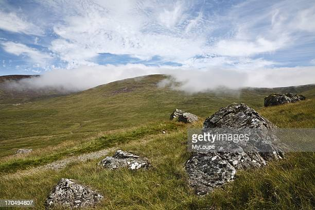View from the Ott Track clouds covering the tops of Slieve Loughshannagh and Slieve Meelbeg Mourne Mountains County Down Northern Ireland United...