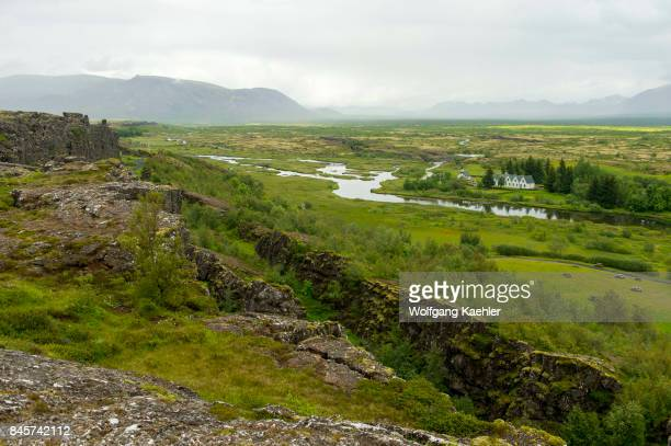 View from the overlook of Thingvellir a site of historical cultural and geological significance showing the rift valley that marks the crest of the...