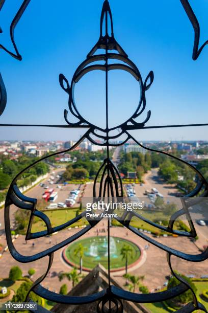 view from the patuxai victory gate, lang xang avenue, pha that luang, vientiane, laos - peter adams stock pictures, royalty-free photos & images