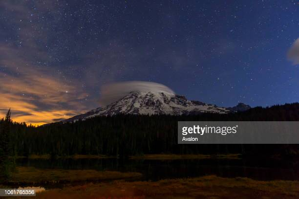 View from the Reflection Lakes of Mount Rainier and stars at night in Mt Rainier National Park in Washington State USA