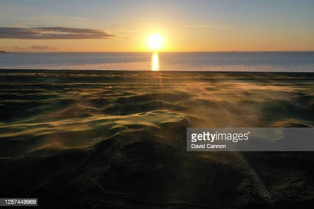 A view from the right of the approach to the green on the par 4 10th hole as the sun rises at the host venue for the 2021 Open Championship at The...