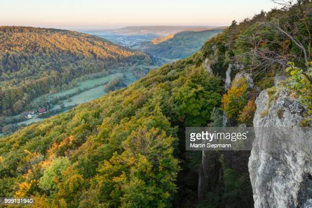 view from the roethelfels or roetelfels climbing rock, altental valley at front, wiesenttal valley at back, in the morning, franconian switzerland, upper franconia, franconia, bavaria, germany - look back at early colour photography imagens e fotografias de stock