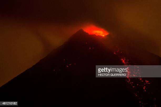 View from the San Antonio community Colima State Mexico on July 18 2015 of the Fire volcano in eruption Hundreds of people were evacuated from...