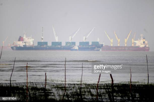 View from the seaside with huge ship transporting containers. Over seven million of people living in the coastal area of Bangladesh to earn their...