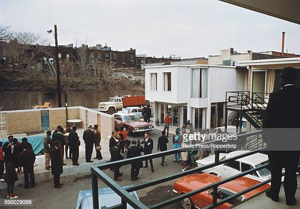 View from the second floor balcony of the Lorraine Motel overlooking the car park containing members of the press and bystanders in Memphis United...