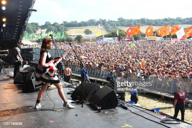 View from the side of the stage of Kate Nash performing showing the crowds at Glastonbury Festival in 2010