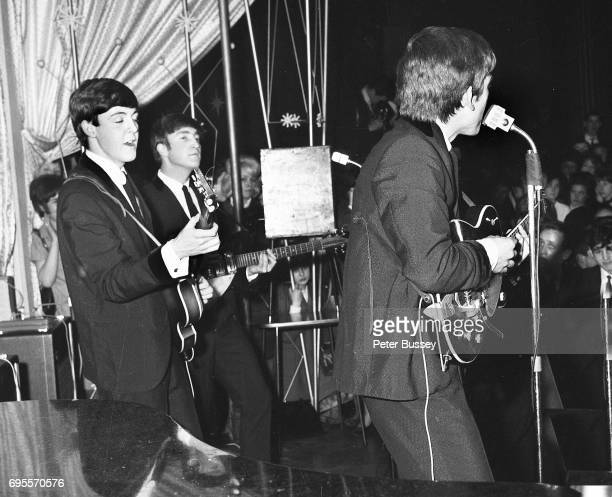 A view from the side of the stage of The Beatles performing at the Majestic Ballroom Finsbury Park London 24th April 1963 LR Paul McCartney John...
