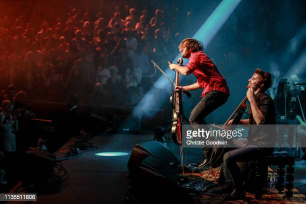 View from the side of the stage showing the audience watching Stjepan Hauser and Luka Sulic of 2Cellos perform at Royal Albert Hall on November 28...