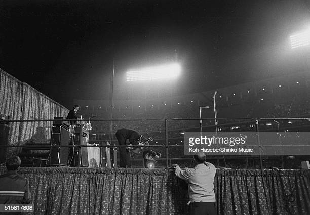 A view from the side of the stage showing The Beatles take a bow at the end of their show at at Dodger Stadium Los Angeles California August 28 1966