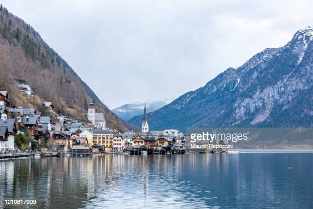 view from the south of hallstatt town, the lake and mountains in austria. - calm before the storm stock pictures, royalty-free photos & images