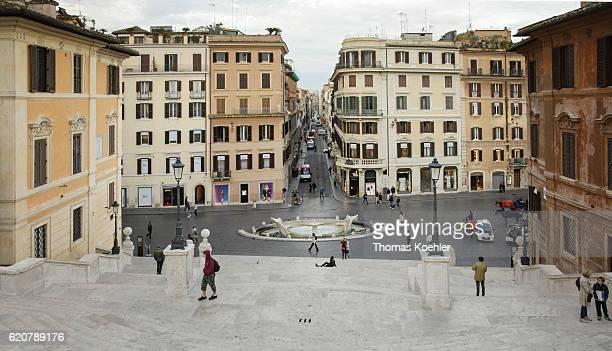 View from the Spanish Steps to Piazza di Spagna Scalinata di Trinita dei Monti and Fontana della Barcaccia on October 13 2016 in Rome Italy