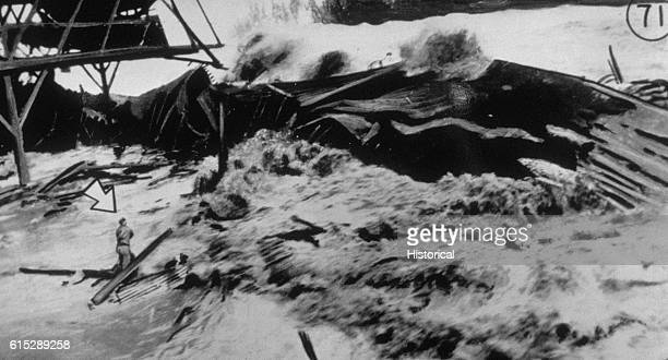 A man is about to be killed by a tsunami as it sweeps over Hilo's Pier 1 on April 1 1946 This man was one of 159 people killed by the wall of water...