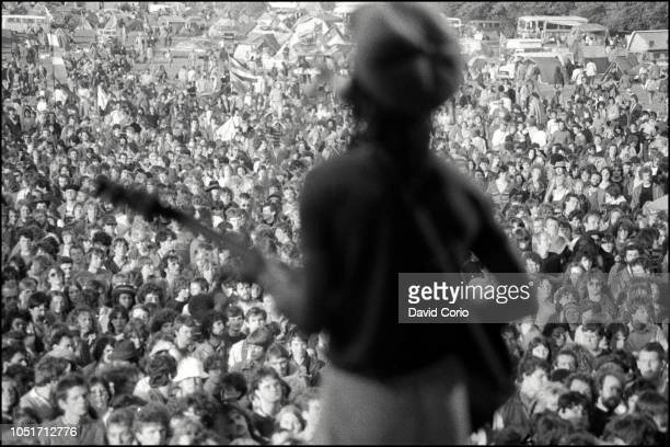 View from the stage as Brinsley Forde of Aswad performs at Glastonbury Festival United Kingdom 18 June 1982