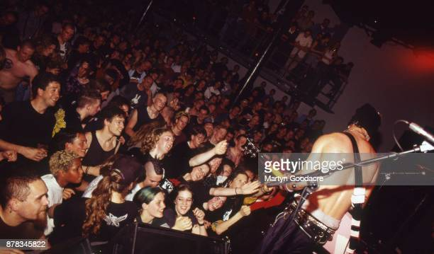 A view from the stage showing the audience watching and cheering as Tim Armstrong of Rancid performs at Paradiso Amsterdam Netherlands 1995