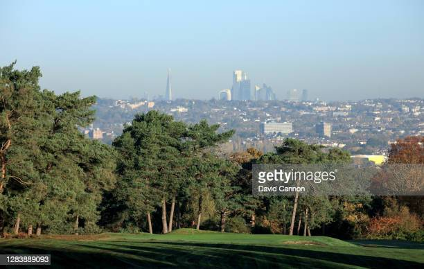 View from the tee of the green on the short par 4, 14th hole with the city of London skyline in the distance at The Addington Golf Club on November...