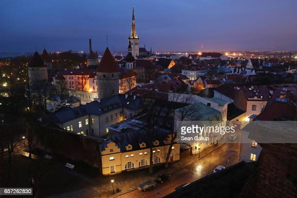 A view from the terrace on Toompea hill shows the historic city center including St Olaf's Baptist Church at twilight on March 22 2017 in Tallinn...