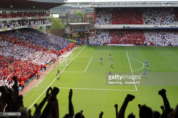 A view from the terraces as Thierry Henry celebrates scoring Arsenal's 2nd goal during the Premier League match between Arsenal and Wigan Athletic on...