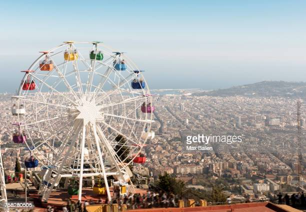 view from the tibidabo amusement park with the giradabo big wheel, barcelona, catalonia, spain - tibidabo stock pictures, royalty-free photos & images