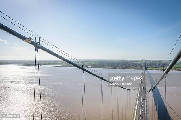 view from the top of suspension bridge. the humber bridge, uk was built in 1981 and at the time was the worlds largest single-span suspension bridge - monty shadow stock photos and pictures
