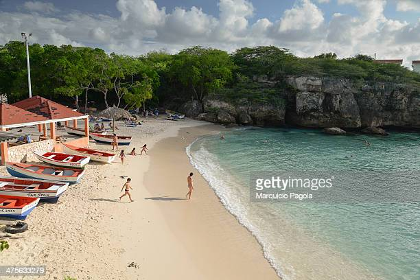 View from the top of the cliffs at Lagun Beach towards the beach, Curacao, Netherland Antilles. A couple of persons can be seen walking towards the...