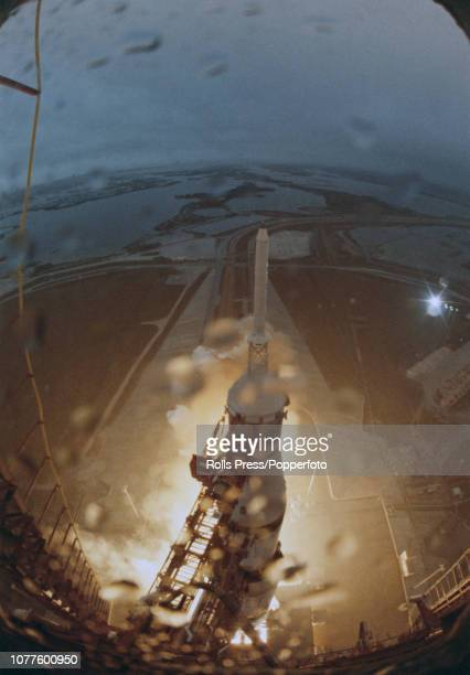 View from the top of the Launch Umbilical Tower of a Saturn V SA507 rocket blasting off during launch from Kennedy Space Center carrying the Apollo...